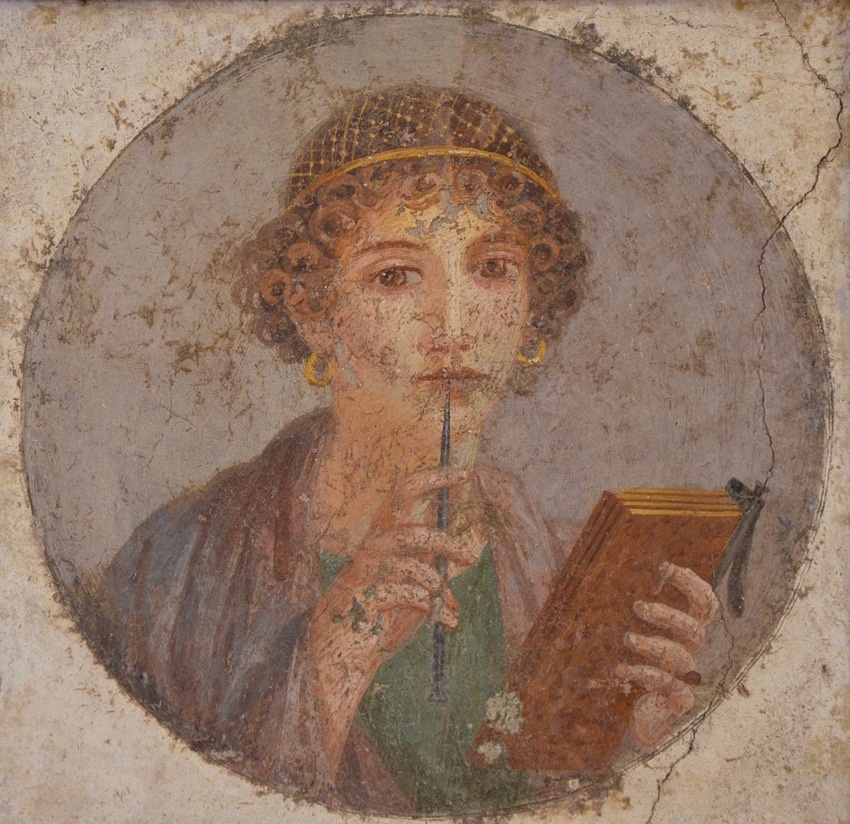 Fresco from Pompeii of woman with a stylus