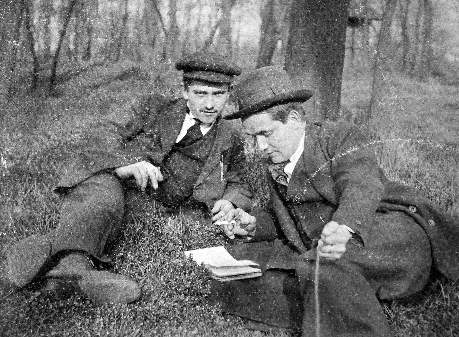 Men reading in the woods